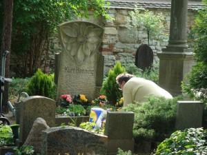 A person paying respect at the grave