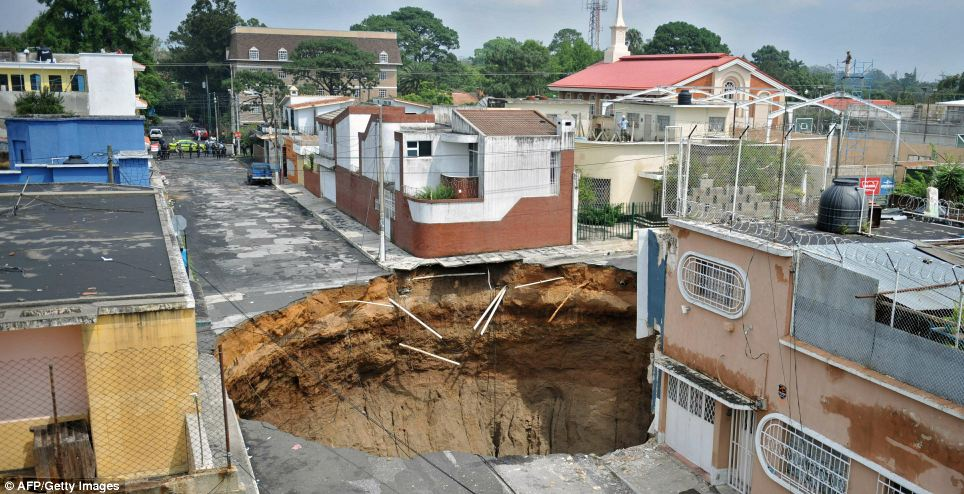 Lucky escape: Neighbouring buildings are left untouched after torrential rain led to this huge crater forming in the capital. The area has been closed off and evacuated  Read more: http://www.dailymail.co.uk/news/worldnews/article-1283066/Guatemala-sink-hole-Tropical-storm-Agatha-blows-200ft-hole-city.html#ixzz0pbH6yO4l