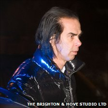 Nick Cave and his twin sons walked away from the scene uninjured