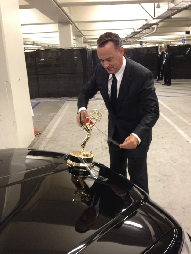 Tom Hanks attempts to turn his limo car into a Rolls Royce... by taping his Emmy to car bonnet