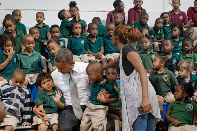 Kissing students steal the show at president's photo op