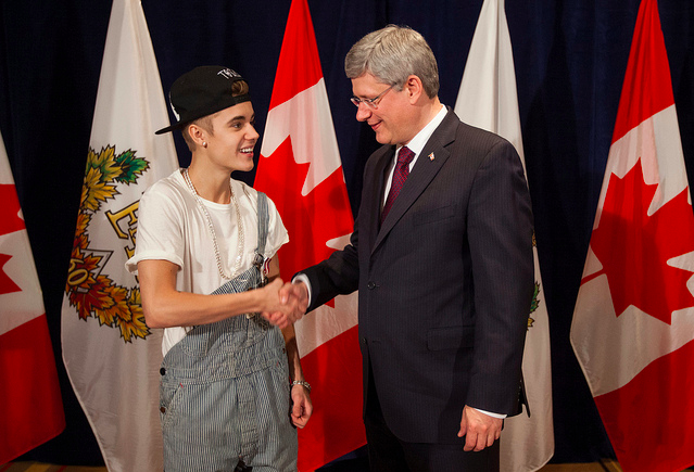 Prime Minister of Canada Stephen Harper presents Justin Bieber with Diamond Jubliee Medal.
