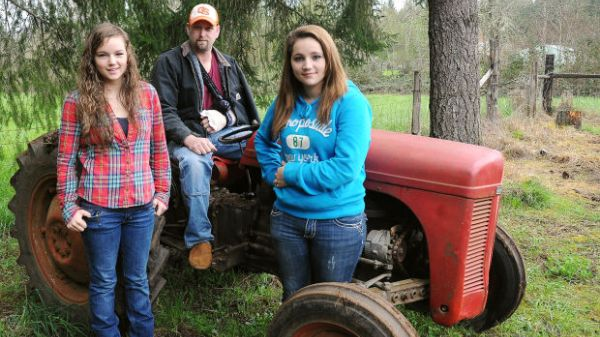 Two girls lift tractor off dad: Teens lift 3,000 pound tractor, save father
