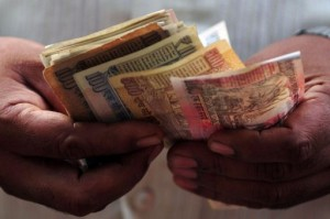 India's rupee skids to new record low against dollar.